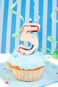 boy's fifth birthday cupcake with blue frosting