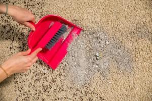 Broom, dirt on a carpet